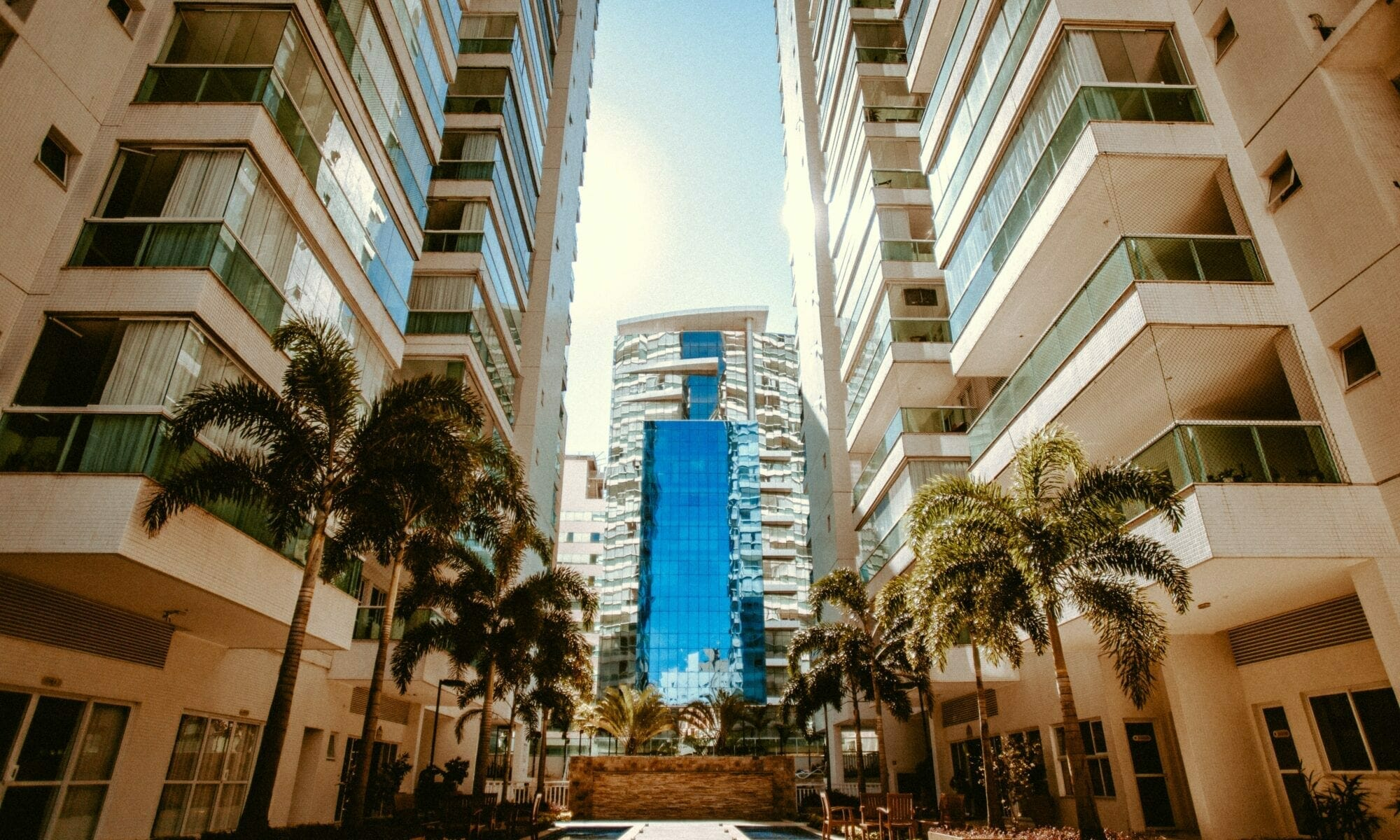 low-angle photography of two white high-rise buildings